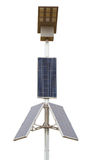 Los paneles solares con la lámpara llevada sobre blanco Imágenes de archivo libres de regalías