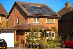 Los paneles solares en casa Imagen de archivo libre de regalías