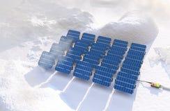 Los paneles solares en invierno Imagen de archivo