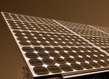 Los paneles solares produciendo Powerage Imagen de archivo libre de regalías