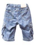 Los pantalones cortos viejos de la mezclilla aislaron foto de archivo libre de regalías