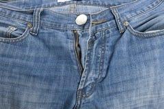 Los pantalones vaqueros se cierran para arriba Foto de archivo libre de regalías