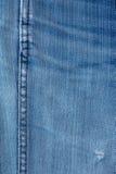 Los pantalones vaqueros texture con la costura Fotografía de archivo libre de regalías