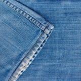 Los pantalones vaqueros texture con la costura Imagenes de archivo