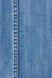 Los pantalones vaqueros texture con la costura Imagen de archivo