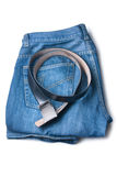 Los pantalones vaqueros y la correa son combinados por una pila Fotografía de archivo libre de regalías