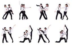 Los pares de bailarines que bailan danzas modernas Foto de archivo libre de regalías