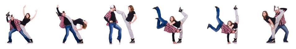 Los pares de bailarines que bailan danzas modernas Fotografía de archivo libre de regalías