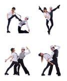 Los pares de bailarines que bailan danzas modernas Fotos de archivo libres de regalías