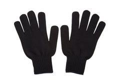 Los pares de negro hacen punto los guantes aislados en el fondo blanco Fotografía de archivo
