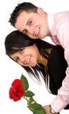 Los pares felices con se levantaron Fotos de archivo libres de regalías