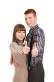 Los pares felices que gesticulan los pulgares suben la muestra Imagen de archivo