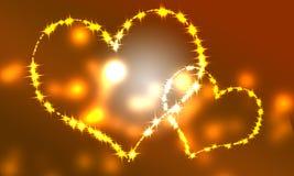 Los pares grandes y pequeños del corazón broncean el fondo de la luz Imágenes de archivo libres de regalías