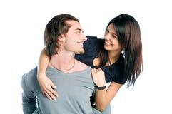 Los pares jovenes se divierten con amor junto Imagenes de archivo