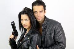 Los pares perfectos se vistieron en una chaqueta de cuero negra Fotografía de archivo libre de regalías