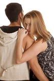 Los pares se sientan cómodamente su pulgar de la mirada en boca Imagen de archivo libre de regalías