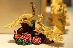 Los pavos reales del oro Imagenes de archivo