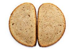 Los pedazos de grano empanan aislado en el fondo blanco Imagen de archivo