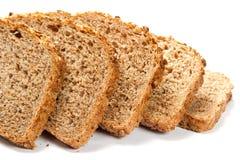 Los pedazos de grano empanan aislado en el fondo blanco Imagen de archivo libre de regalías