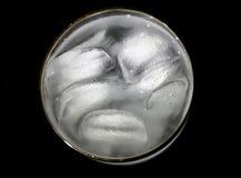 Los pedazos de hielo en un vidrio Imágenes de archivo libres de regalías