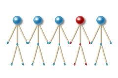 Los pequeños hombres hechos de los partidos azules uno de ellos son diferentes Imagen de archivo