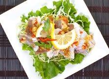 Los pescados cocidos al vapor calientes y picantes en limón sauce Fotos de archivo libres de regalías