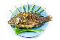 Los pescados frieron aislado en blanco Imagenes de archivo