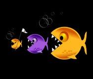 Los pescados grandes comen pequeños pescados Imagen de archivo libre de regalías