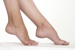 Los pies desnudos de la mujer Fotos de archivo libres de regalías