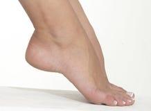 Los pies desnudos de la mujer Imagenes de archivo