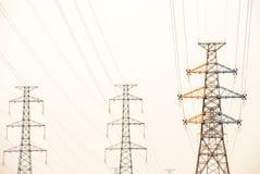 Los pilones de la electricidad foto de archivo libre de regalías
