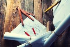 Los planes y las herramientas del carpintero Visión superior Foto de archivo