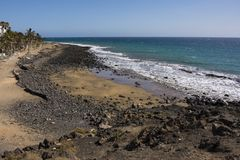 Los pocillos beach peurto de carmen lanzarote. Looking along los pocillos beach peurto del Carmen Lanzarote canary islands on a bright clear cloudless day in Stock Photos
