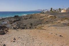 Los pocillos beach peurto de carmen lanzarote. Looking along los pocillos beach peurto del Carmen Lanzarote canary islands on a bright clear cloudless day in Royalty Free Stock Photo