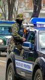Los polis disfrazan en la misión Imagenes de archivo