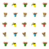 Los potes de flores coloridos cuelgan sobre la pared Imagen de archivo libre de regalías