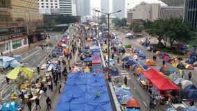 Los Protestors en la revolución 2014 del paraguas de las protestas de Harcourt Road Occupy Admirlty Hong Kong ocupan la central Fotos de archivo libres de regalías