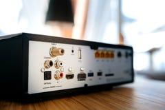 Los puertos múltiples para la conexión detrás de la TV encajonan audio óptico Foto de archivo libre de regalías