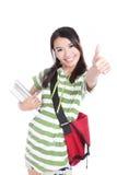 Los pulgares de la estudiante suben gesto de mano Imagen de archivo libre de regalías