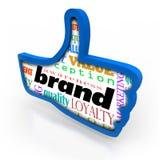 Los pulgares de la lealtad del marketing de producto de la marca suben símbolo Foto de archivo