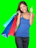Los pulgares de la mujer de las compras suben éxito Imagen de archivo