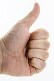 Los pulgares encima del gesto se realizaron por la mano humanCaucasian real Esta imagen se puede también utilizar para representa foto de archivo