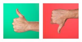 Los pulgares para arriba y los pulgares abajo firman en verde y rojo imagen de archivo