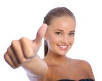 Los pulgares positivos suben el éxito para la chica joven feliz Fotografía de archivo libre de regalías
