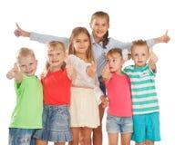 Los pulgares suben a niños Fotografía de archivo