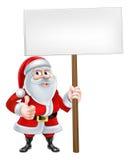 Los pulgares suben a Santa Sign Imagen de archivo libre de regalías