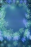 Los puntos del bokeh azul encienden el modelo en forma de un bastidor Imagenes de archivo
