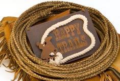 Los rastros felices firman circundado con la cuerda del lazo del cuero crudo Imagen de archivo libre de regalías