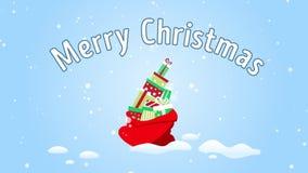 Los regalos coloridos de la Navidad caen en el bolso de Papá Noel Saludo de la e-tarjeta con Feliz Navidad del texto metrajes