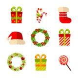 Los regalos de la Navidad, del Año Nuevo y las guirnaldas, vector el plano ilustración del vector